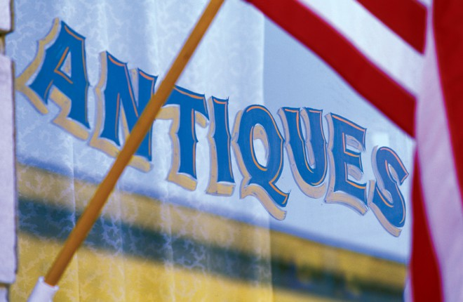 Old-fashioned window lettering hints at the treasures waiting within Yesterday's Antiques.