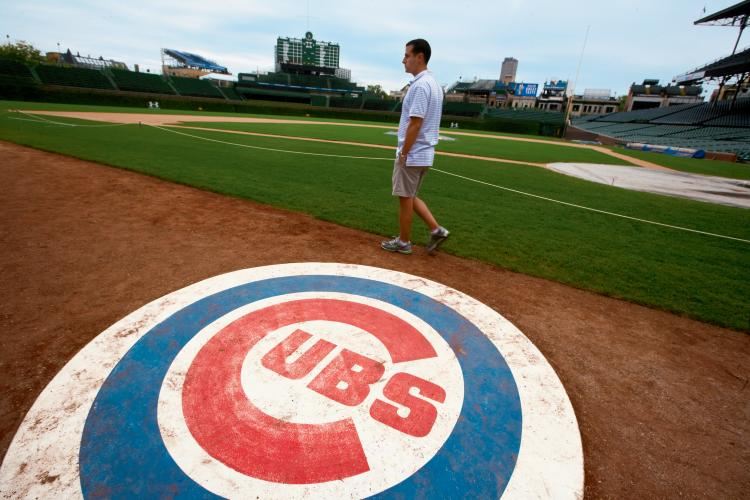 The expansive grass at Wrigley Filed as seen from the third base on deck circle. The groundskeepers at Wrigley Field, in Chicago, home of the Cubs, are among the best qualified to give lawn care tips because they have to deal with keeping grass healthy every day.