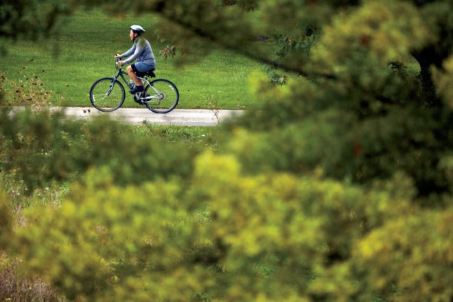 A bicyclist rides at Waubonsie Lake Park, part of the Fox Valley Parks District, in Aurora.