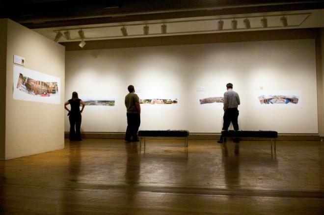 Jamie Grites, Ben Gardner and Douglas Johnson enjoy the exhibition at the McLean County Arts Center.