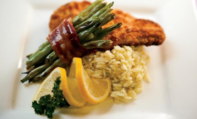 Parmesan crusted chicken breasts with bacon-wrapped green bean bundles and classic rice pilaf for quick-fix meals.