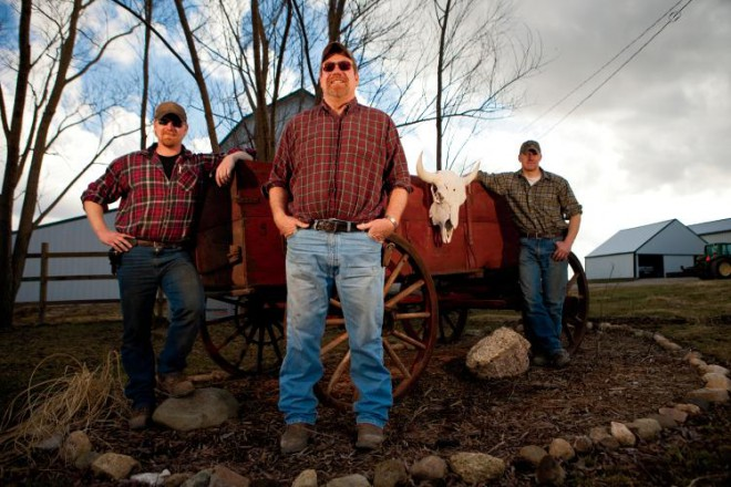 Terry Lieb, center, poses with his sons, Josh, left, and Jake at the family farm in Monticello, Il. Terry Lieb starting raising bison about 8 years ago when he bought his first bison for his farm in Monticello, Il. Since then, Lieb has grown his herd to about 20 bison and has converted 60 acres from his soybean fields into pasture for the enormous creatures that reach upwards of 2000 pounds.