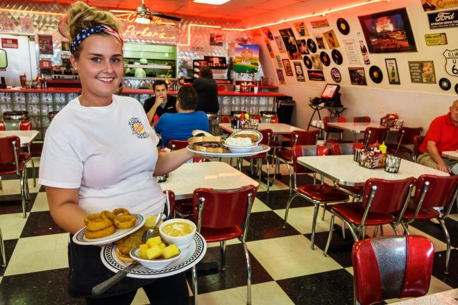 Springfield Illinois Historic Route 66 Charlie Parker's Diner restaurant inside interior 1950's 50's theme decor woman waitress serving food employee